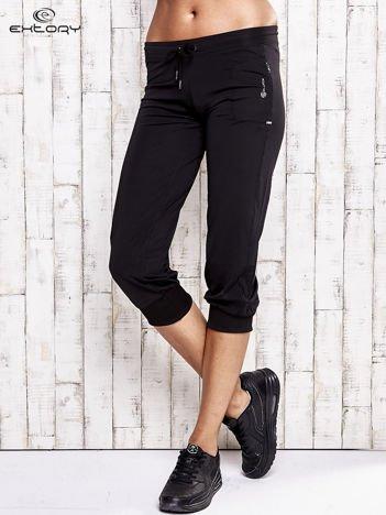 Czarne spodnie damskie capri z wszytą kieszonką
