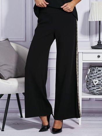 Czarne spodnie z cekinowym lampasem