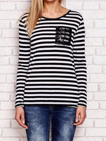 Czarno-biała bluzka w paski z cekinowymi motywami