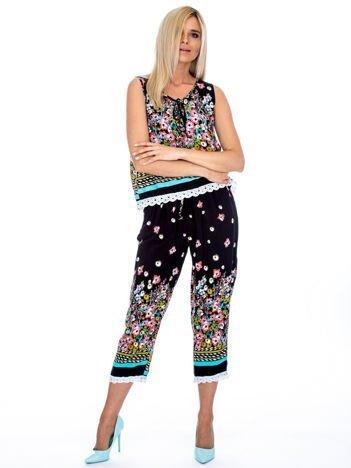 Czarny komplet damski w kolorowe wzory top i spodnie