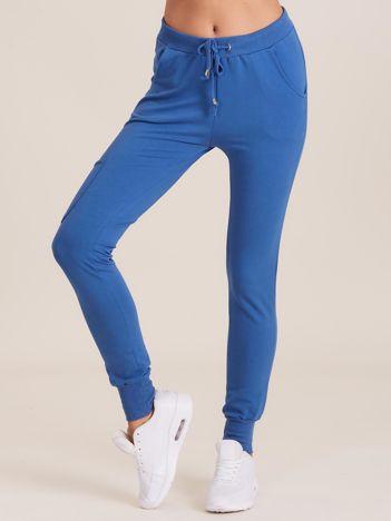 Damskie spodnie dresowe ze ściągaczami ciemnoniebieskie