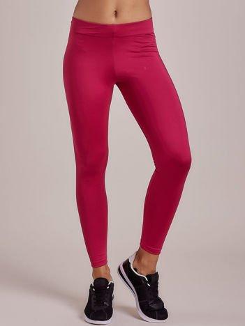 Długie ciemnofuksjowe legginsy fitness o średniej grubości