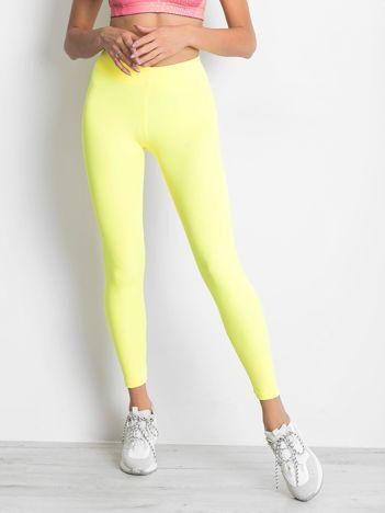 Długie fluo żółte legginsy fitness o średniej grubości