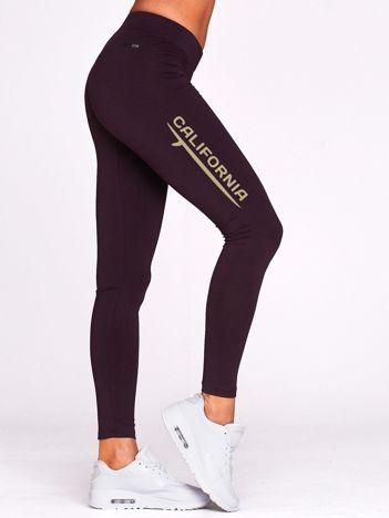 Długie legginsy na siłownię z napisem CALIFORNIA ciemnofioletowe