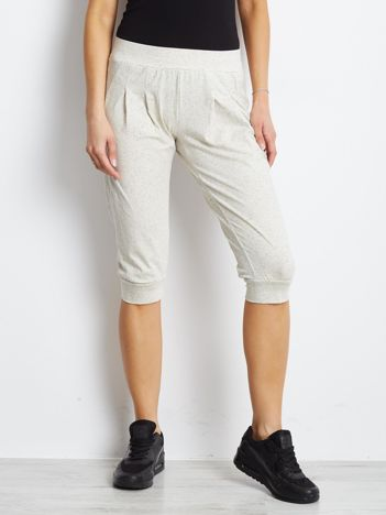 Ecru spodnie dresowe typu capri długości 3/4