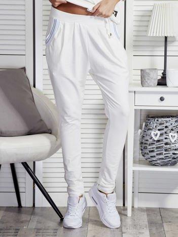 Ecru spodnie dresowe ze ściągaczami przy kieszeniach