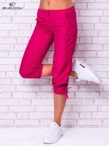 Fioletowe spodnie sportowe capri z guzikami
