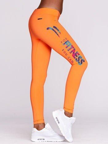 Fluo pomarańczowe długie legginsy fitness z kolorowym nadrukiem