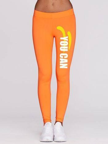 Fluo pomarańczowe długie legginsy fitness z kontrastowym nadrukiem