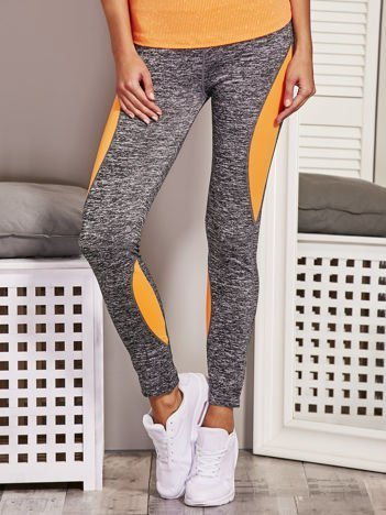Fluo pomarańczowe legginsy melange z kolorowymi wstawkami