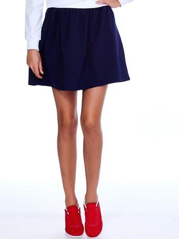 Granatowa rozkloszowana dresowa spódnica z kieszeniami