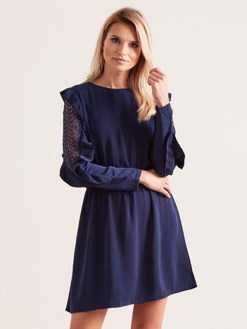 Granatowa sukienka  z falbanami na rękawach