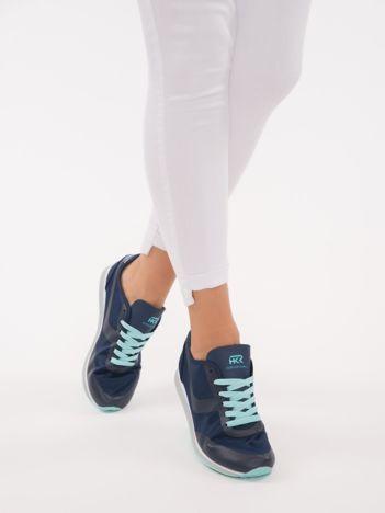 Granatowe lekkie buty sportowe na sprężystej podeszwie z turkusowymi dodatkam