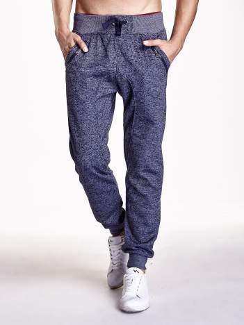 Granatowe melanżowe spodnie z zasuwanymi kieszeniami