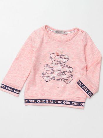 Jasnoróżowa bluzka dla dziewczynki z perełkami