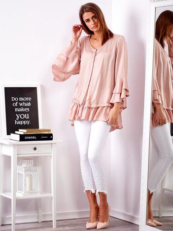 Jasnoróżowa bluzka z falbanami