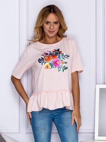 Jasnoróżowa bluzka z kolorowymi kwiatami