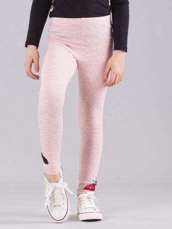 Jasnoróżowe legginsy dziewczęce z aplikacją