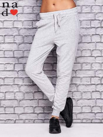 Jasnoszare spodnie dresowe z troczkami