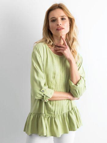 Jasnozielona bluzka damska z falbaną