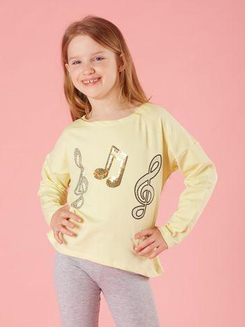 Jasnożółta bluzka dziewczęca z muzyczną aplikacją