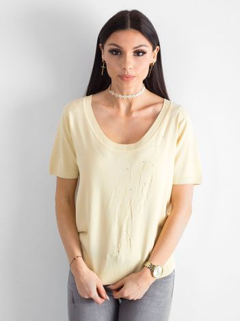 Jasnożółta bluzka z głębokim dekoltem