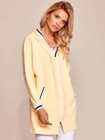 Jasnożółta długa bluza rozpinana z kapturem