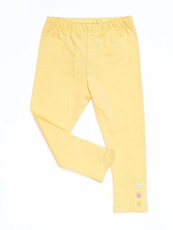 Jasnożółte legginsy dla dziewczynki z kolorowymi guzikami