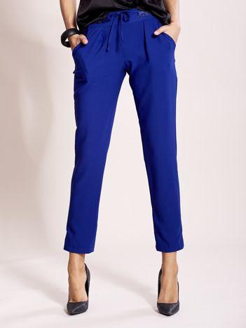 Kobaltowe spodnie joggersy z troczkami
