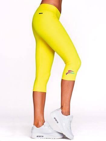 Krótkie legginsy do ćwiczeń z kolorowym logo żółte