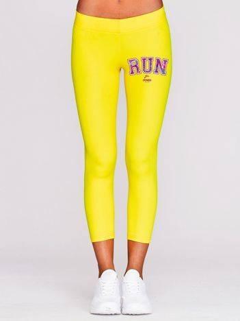 Legginsy do biegania z kolorowym napisem RUN żółte