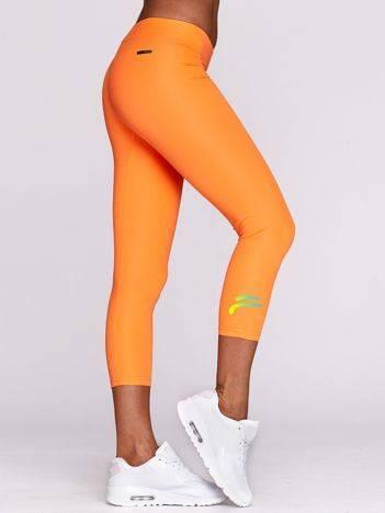 Legginsy do biegania z nadrukiem logo fluopomarańczowe
