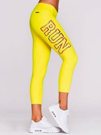 Legginsy do biegania z napisem RUN na boku żółte