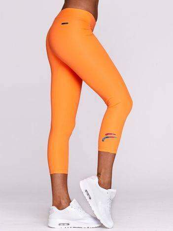 Legginsy na siłownię z logo na nogawce fluopomarańczowe