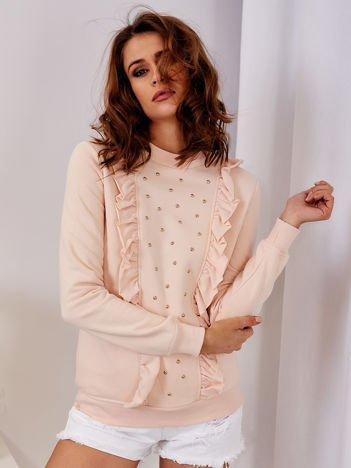 Łososiowa bluza z kolorowymi perełkami i falbankami