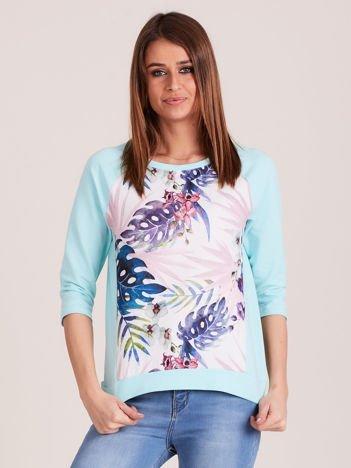 Miętowa bluza z motywem egzotycznych roślin