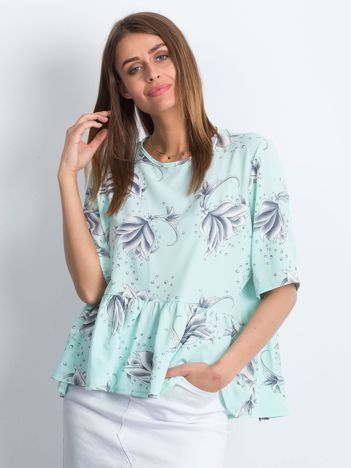 Miętowa bluzka z falbaną we wzory