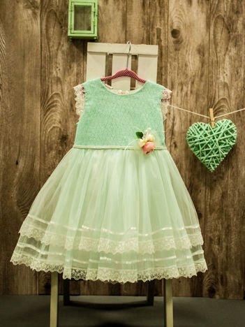 Miętowa elegancka sukienka dziewczęca z ozdobną różyczką