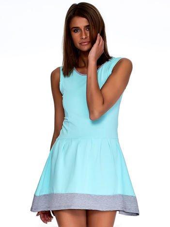 Miętowa sukienka z szarym wykończeniem