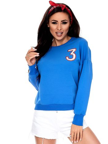 Niebieska bluza z błyszczącą cyfrą