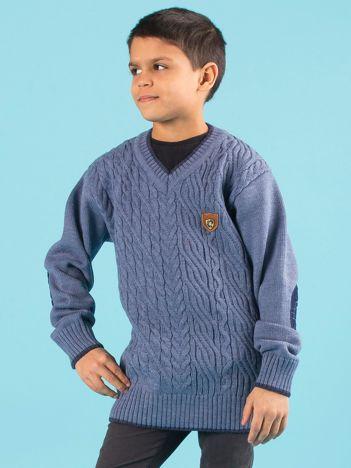 Niebieski chłopięcy sweter w warkocze