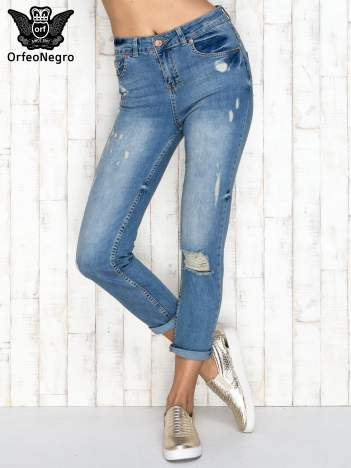 Niebieskie spodnie boyfriend jeans z przetarciami