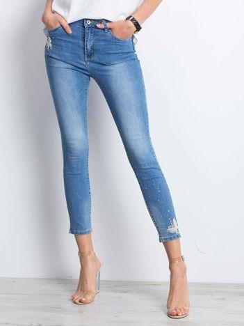 Niebieskie spodnie jeansowe Sheer