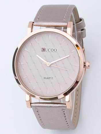 Perłowo złoty zegarek damski z pikowaniami na tarczy