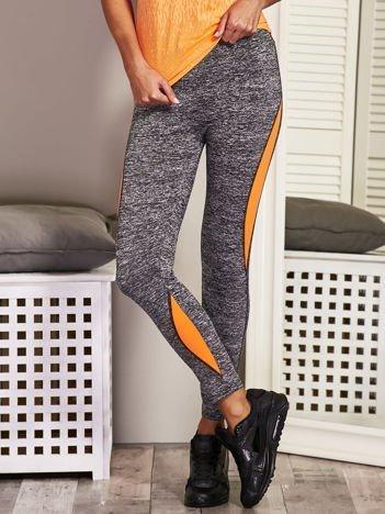 Pomarańczowe legginsy z kolorowymi wstawkami
