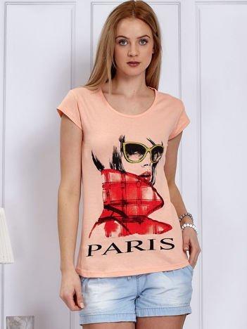 Pomarańczowy t-shirt z dziewczyną i napisem