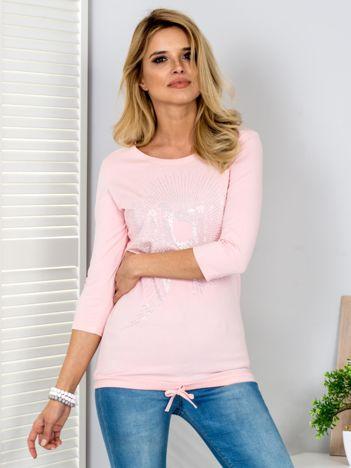 Różowa bluzka z aplikacją z dżetów