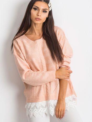 Różowy sweter World
