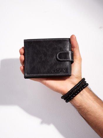 Skórzany portfel dla mężczyzny z zapięciem czarny