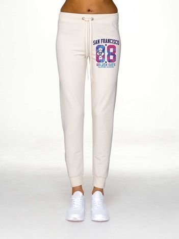 Spodnie dresowe damskie z nadrukiem ecru